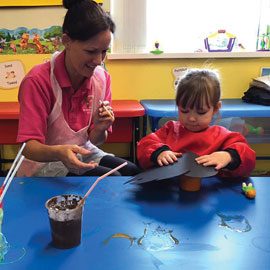 Member of staff with child at Caego Day Nursery